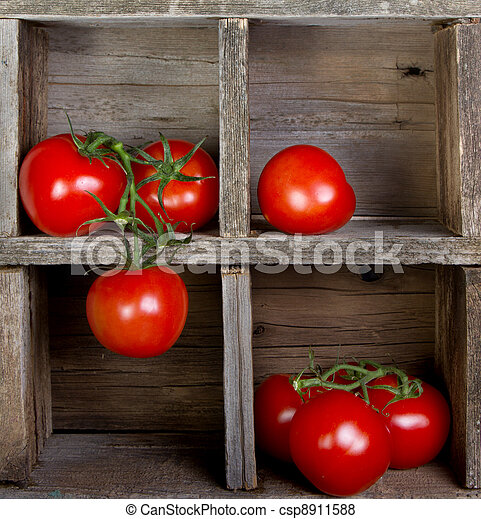 tomatoes in a wooden crate - csp8911588