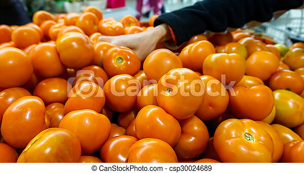 Tomatoes in supermarket - csp30024689
