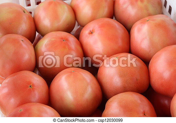 tomatoes piling up together in a market - csp12030099