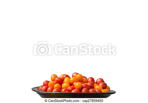 Tomatoes red and yellow on large plate - csp27859450