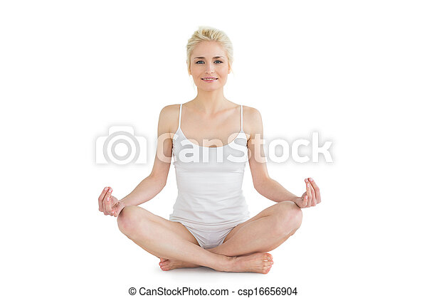 toned young woman sitting in lotus pose full length of a
