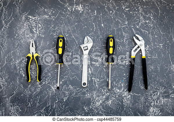 Tools for repairing top view on stone background - csp44485759