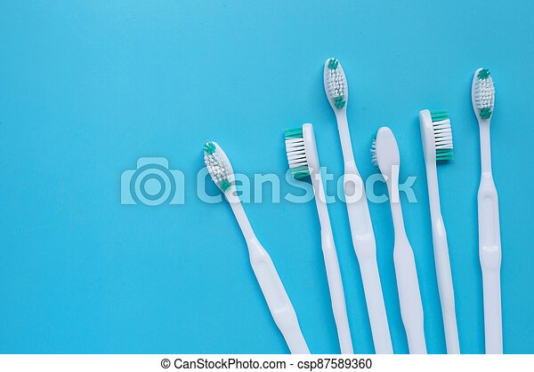 Toothbrushes on blue background. Top view - csp87589360