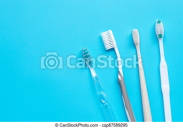 Toothbrushes on blue background. Top view - csp87589295