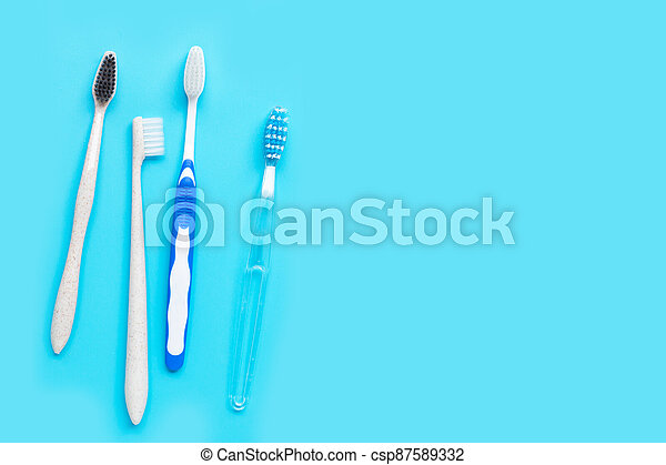 Toothbrushes on blue background. Top view - csp87589332