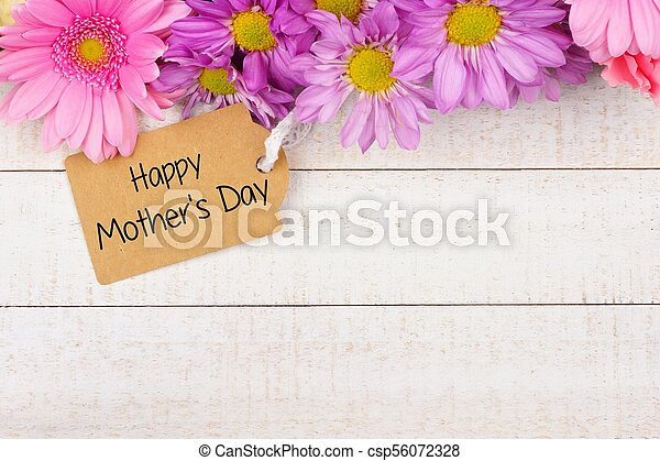 Top border of flowers with Mothers Day gift tag against white wood - csp56072328