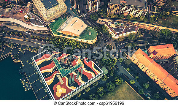 Top down view of a round about above city buildings. - csp61956196