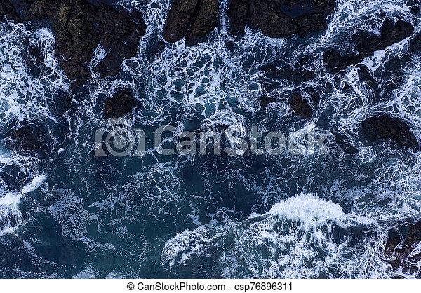 Top down view of giant ocean waves - csp76896311