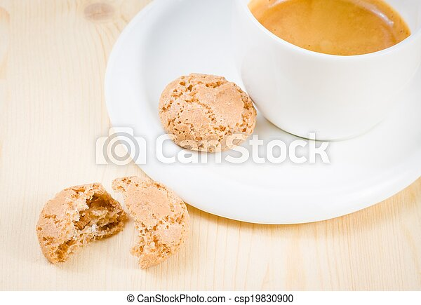 top of view of cup of italian espresso coffee near biscuit - csp19830900