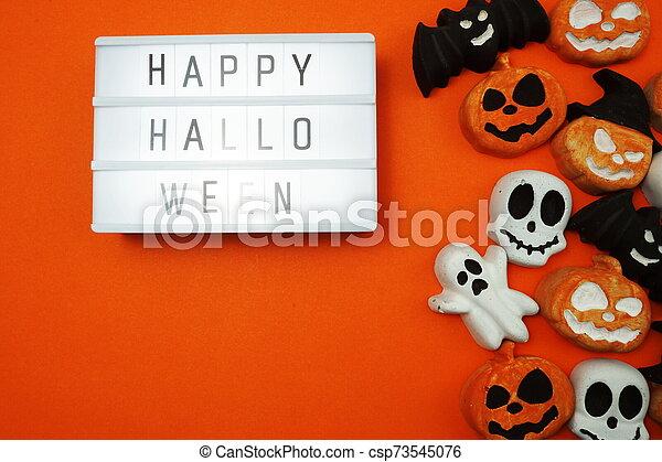 Top view Happy Halloween word in Light box flat lay - csp73545076