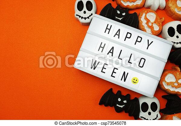 Top view Happy Halloween word in Light box flat lay - csp73545078