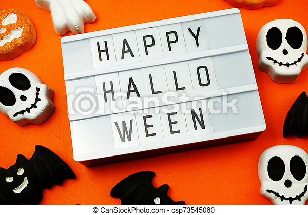 Top view Happy Halloween word in Light box flat lay - csp73545080