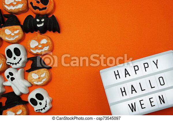 Top view Happy Halloween word in Light box flat lay - csp73545097