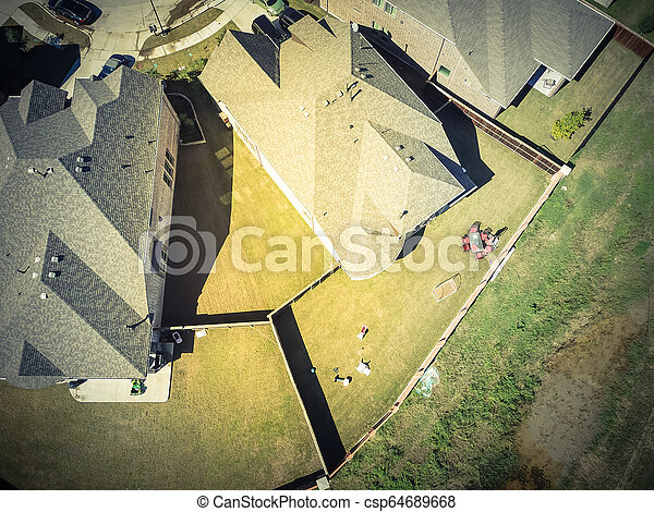 Top view new residential houses neighborhood with garden suburbs - csp64689668
