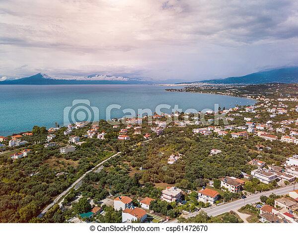 Top view of a coastal line. Aerial drone bird's eye view photo. - csp61472670