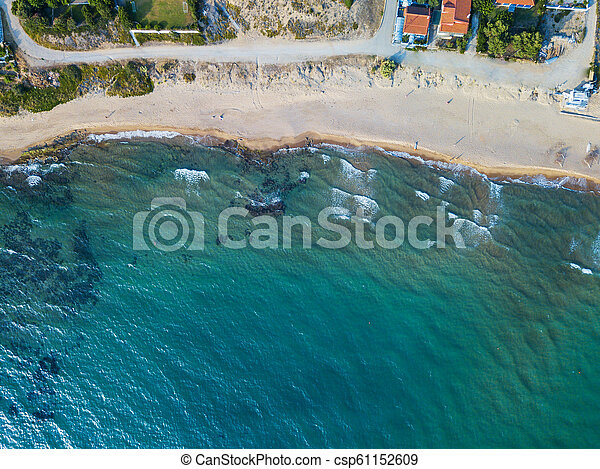 Top view of a coastal line. Aerial drone bird's eye view photo. - csp61152609