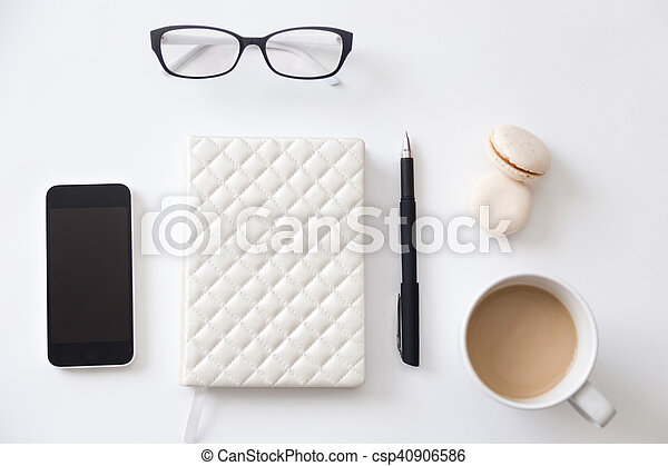 Top view of a working desk with notebook, phone, coffee - csp40906586
