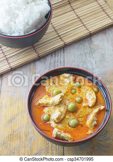 14491e35 Top view of chicken red curry with rice.