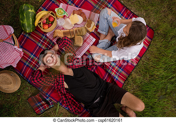 top view of couple enjoying picnic time - csp61620161