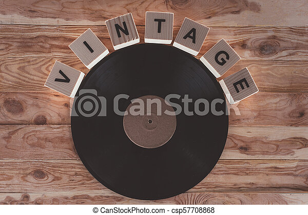 top view of cubes with letters and vinyl record over wooden background - csp57708868