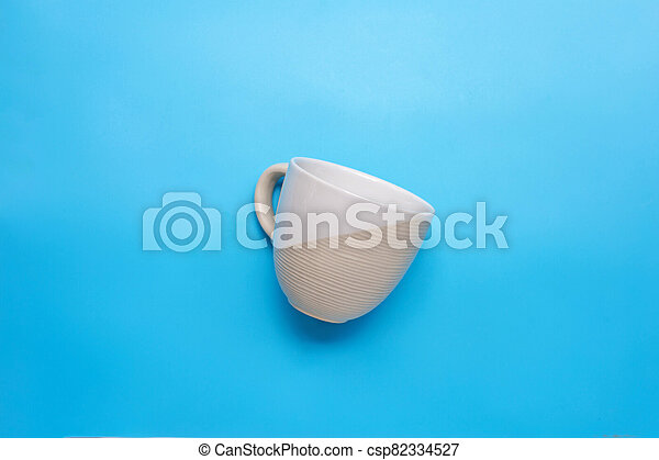Top view of cup on blue background. - csp82334527