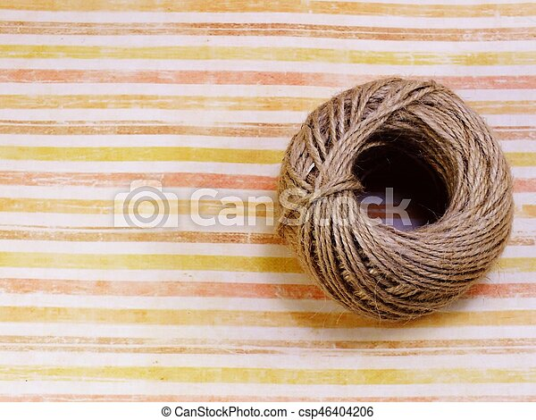 top view of decorative hemp rope roll with space copy background - csp46404206