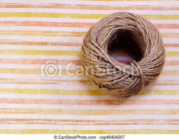 top view of decorative hemp rope roll with space copy background - csp46404207