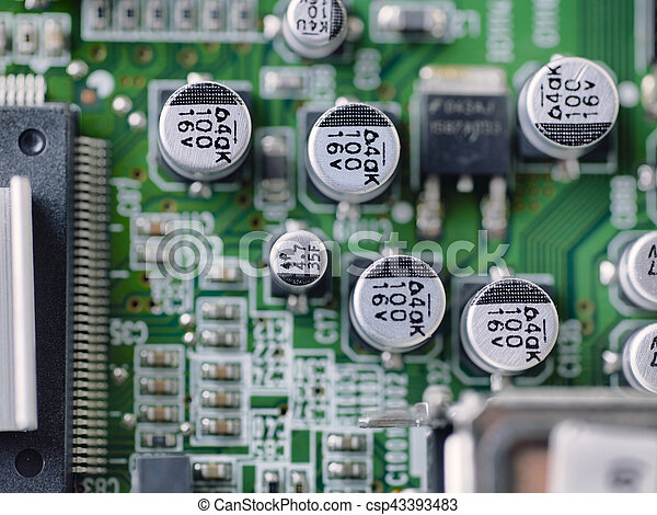 Top view of electronic microcircuit with microchips and capacitors taken closeup. Shallow depth of focus. - csp43393483