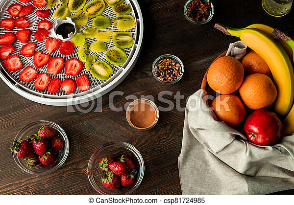 Top view of fresh fruit and spice assortment on wooden kitchen table - csp81724985