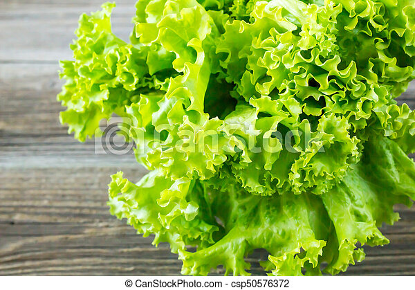 Top view of fresh Lettuce on wooden background - csp50576372