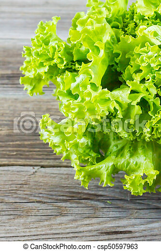 Top view of fresh Lettuce on wooden background - csp50597963