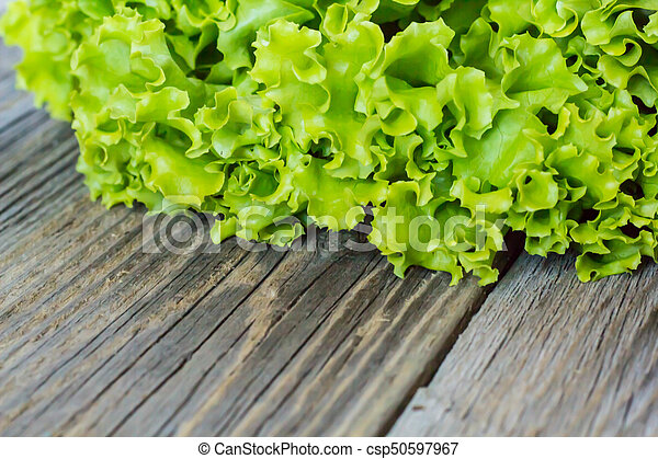 Top view of fresh Lettuce on wooden background - csp50597967
