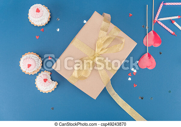 Top view of gift box cakes and candles isolated on blue picture top view of gift box cakes and candles isolated on blue birthday party concept negle Choice Image