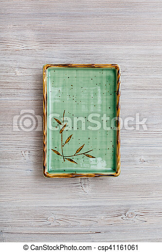 top view of green square plate on gray brown table