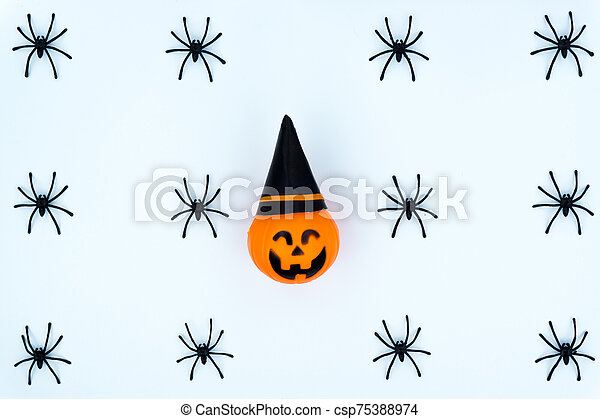 Top view of Halloween decoration, jack o lantern, ghost, bat and spider on white background with copy space for text. halloween concept. - csp75388974