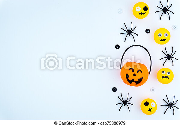 Top view of Halloween decoration, jack o lantern, ghost, bat and spider on white background with copy space for text. halloween concept. - csp75388979