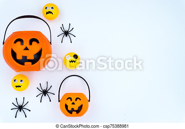 Top view of Halloween decoration, jack o lantern, ghost, bat and spider on white background with copy space for text. halloween concept. - csp75388981