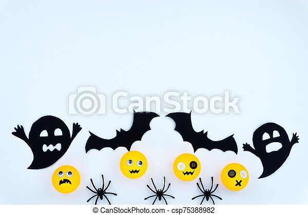 Top view of Halloween decoration, jack o lantern, ghost, bat and spider on white background with copy space for text. halloween concept. - csp75388982