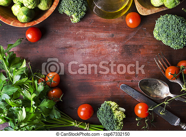 Top view of healthy food ingredients frame on vintage wooden table. Superfood vegetable mix border on rustic background from above. - csp67332150