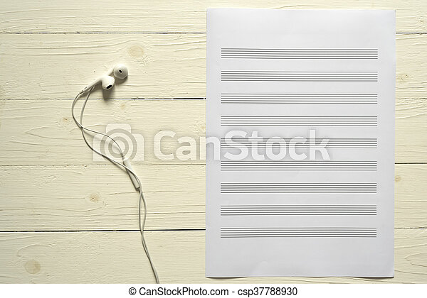 Top View Of Music Staff Paper And Earphone On Wood Backgroud