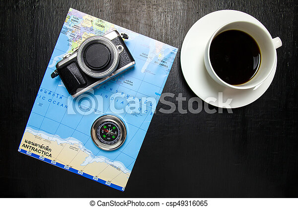 Top view of office desk workspace with coffee cup camera world map top view of office desk workspace with coffee cup camera world map compass gumiabroncs Image collections