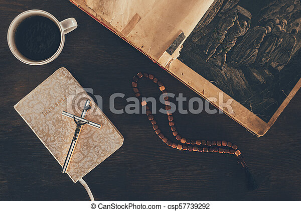 top view of open bible and rosary on wooden table - csp57739292