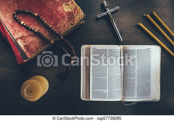 top view of open bible with cross and rosary on table - csp57739285