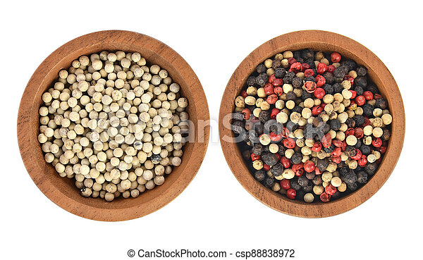 Top view of  pepper in wooden bowl on white background - csp88838972