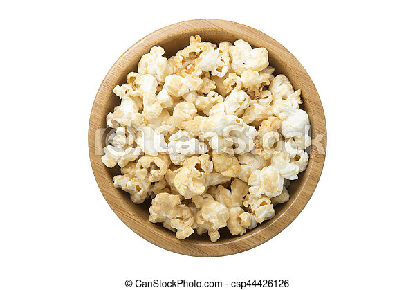 Top view of popcorn in wooden bowl isolated on white - csp44426126