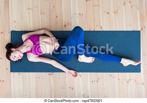 Top View Of Pretty Skinny Young Caucasian Woman Wearing Sportswear Lying On Mat Relaxing After Workout In Gym