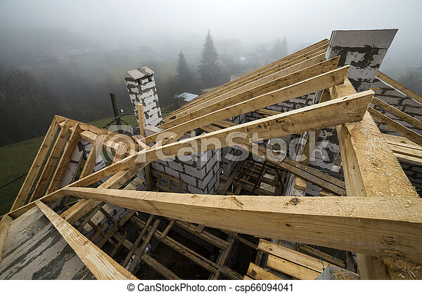 Top View Of Roof Frame From Wooden Lumber Beams And Planks On Walls Made Of Hollow Foam Insulation Blocks Building Roofing Construction And