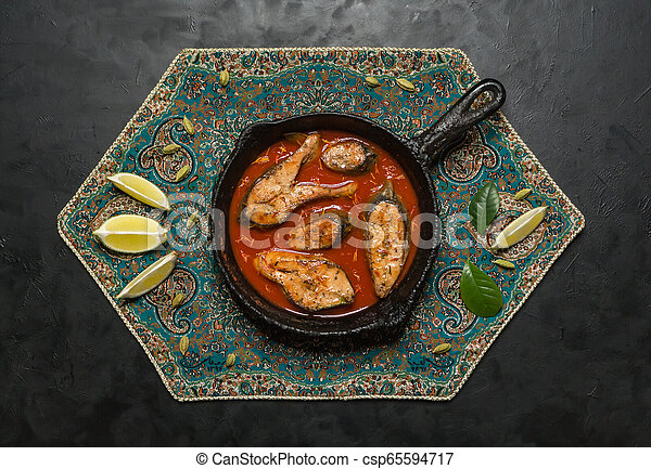 Top view of spicy and hot Bengali fish curry. - csp65594717