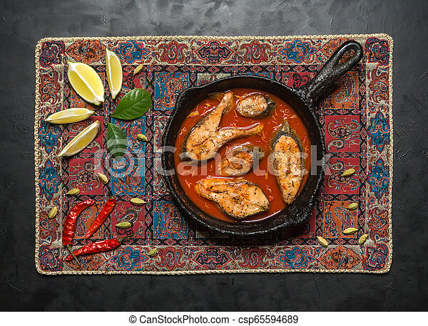Top view of spicy and hot Bengali fish curry. - csp65594689