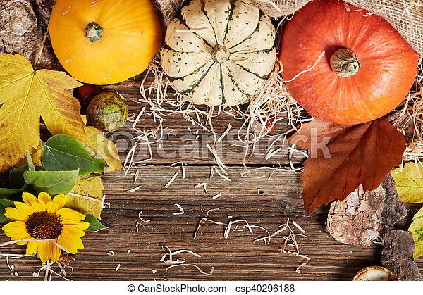 Top view of table with pumpkin and straw - csp40296186